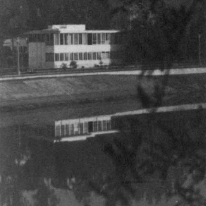A view of VDL House reflected in Silver Lake